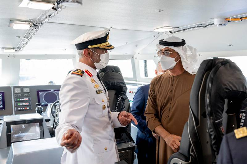 ABU DHABI, UNITED ARAB EMIRATES - February 23, 2021: Rear Admiral Pilot HH Sheikh Saeed bin Hamdan bin Mohamed Al Nahyan, Commander of the UAE Naval Forces (L) speaks with HH Sheikh Mohamed bin Zayed Al Nahyan, Crown Prince of Abu Dhabi and Deputy Supreme Commander of the UAE Armed Forces (R), during a tour at the 2021 Naval Defence and Maritime Security Exhibition (NAVDEX), at ADNEC.   ( Hamad Al Kaabi / Ministry of Presidential Affairs ) ---