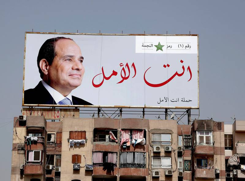 """In this Monday, March 19, 2018 photo, an election banner for Egyptian President Abdel-Fattah el-Sissi hangs on top of a residential building with Arabic that reads, """"you are the hope,"""" on the ring road in Cairo, Egypt. Egyptians on social media are mocking the ubiquitous banners of el-Sissi raised ahead of this month's election. He faces no serious competition, but authorities are pushing for a large turnout to lend legitimacy to the vote. In photos and videos shared online, the banners have been inserted into the background of iconic scenes from movies and TV shows. (AP Photo/Nariman El-Mofty)"""