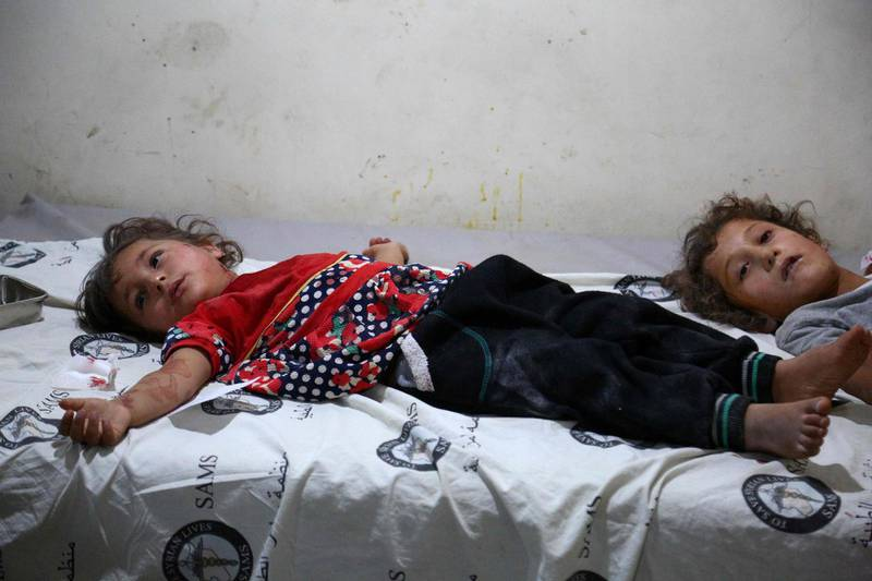 """EDITORS NOTE: Graphic content / Two Syrian girls lie on a makeshift clinic after they were wounded during bombardments in the area of Tallmannis in Syria's northern Idlib province on August 20, 2019. Jihadists and allied rebels withdrew from a key area of northwestern Syria today, a monitor said, as President Bashar al-Assad's forces pressed an offensive against the jihadist-run Idlib region. Turkey warned Damascus """"not to play with fire"""" a day after a Syrian regime air strike sought to deter a new Turkish military convoy from entering the area.  / AFP / Zein Al RIFAI"""