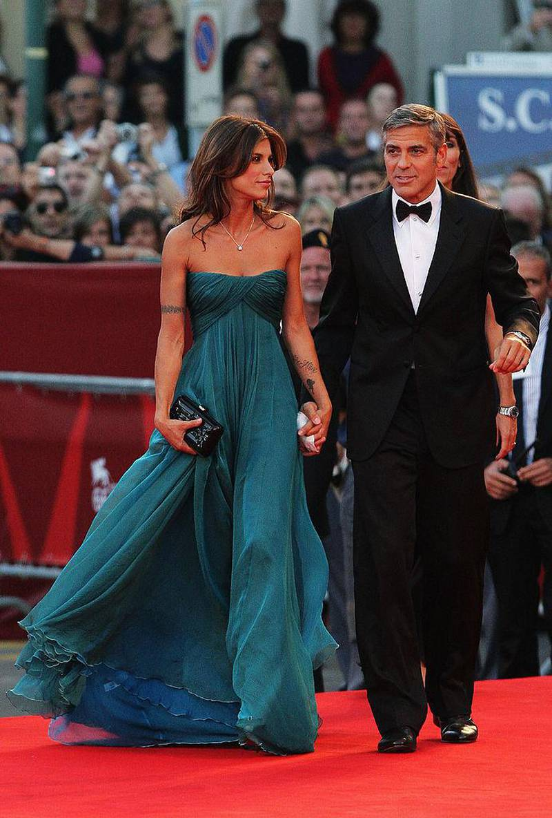 """VENICE, ITALY - SEPTEMBER 08:  Actor George Clooney and his girlfriend Elisabetta Canalis attend """"The Men Who Stare At Goats"""" premiere at the Sala Grande during the 66th Venice Film Festival on September 8, 2009 in Venice, Italy.  (Photo by Dan Kitwood/Getty Images)"""