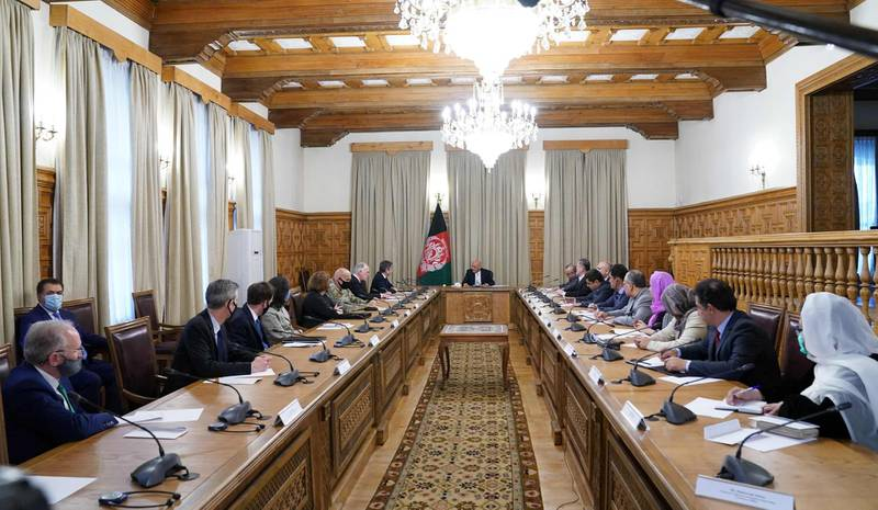 """In this handout photograph taken on April 15, 2021 and released by Press office of President of Afghanistan shows US Secretary of State Antony Blinken (9L) meeting with Afghan President Ashraf Ghani (C), in Kabul.  RESTRICTED TO EDITORIAL USE - MANDATORY CREDIT """"AFP PHOTO /  """" - NO MARKETING - NO ADVERTISING CAMPAIGNS - DISTRIBUTED AS A SERVICE TO CLIENTS  / AFP / Afghan Presidential Palace / - / RESTRICTED TO EDITORIAL USE - MANDATORY CREDIT """"AFP PHOTO /  """" - NO MARKETING - NO ADVERTISING CAMPAIGNS - DISTRIBUTED AS A SERVICE TO CLIENTS"""