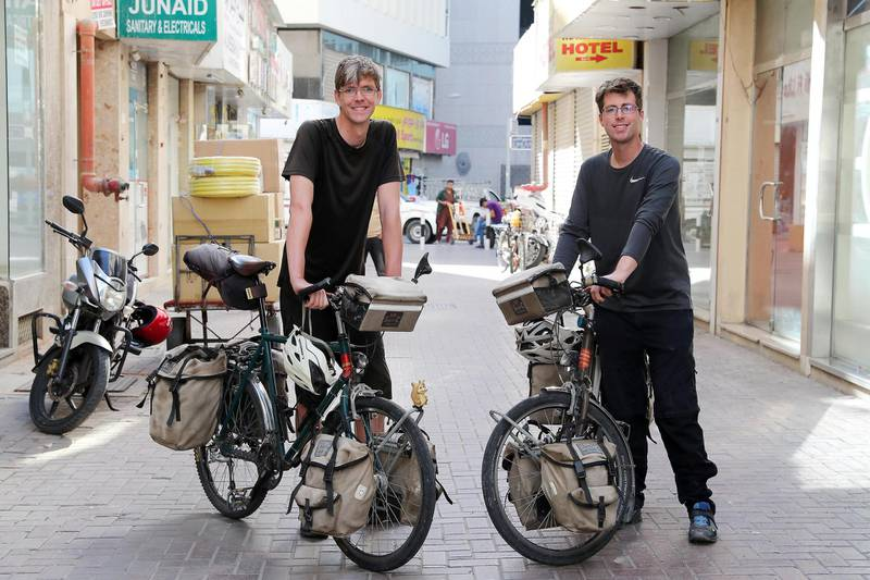 DUBAI , UNITED ARAB EMIRATES , February 07 – 2019 :- Left to Right – Dominik Fischer and Simon Helmecke with their bicycles outside their Royal Creek hotel in Deira in Dubai. They are cycling around the world. ( Pawan Singh / The National ) For News. Story by Patrick