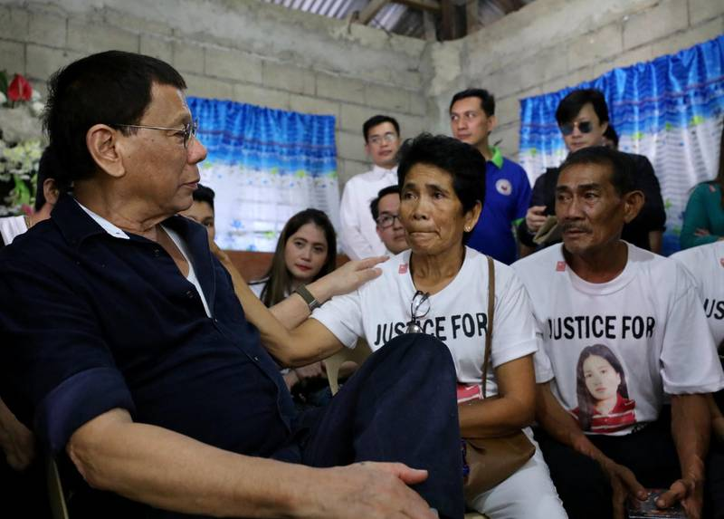 epa06553691 A handout photo made available by the Philippine Presidential Photographs Division (PPD) shows Philippine President Rodrigo Duterte (L) speaking to the parents of Overseas Filipino Worker (OFW) Joanna Demafelis during a wake in the town of Sara, Iloilo province, Philippines, 22 February 2018. Overseas domestic worker Joanna Demafelis, who was found dead, had been stuffed in an apartment's freezer in Kuwait after she died due to a severe beating. The Philippine government has banned the deployment of Filipino domestic workers to Kuwait following reports of sexual, mental, and physical abuse that has allegedly led to several deaths and injuries among migrant workers.  EPA/RICHARD MADELO-HO HANDOUT  HANDOUT EDITORIAL USE ONLY/NO SALES