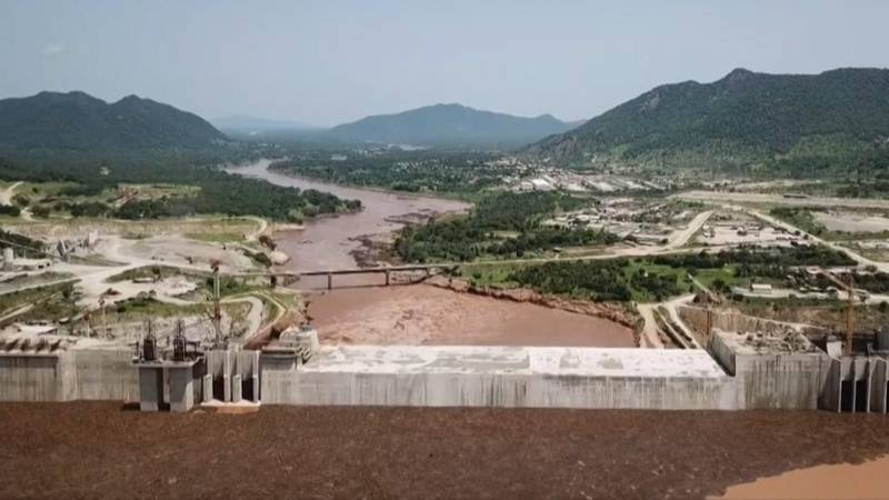 """This frame grab from a video obtained from the Ethiopian Public Broadcaster (EBC) on July 20 and July 21, 2020 and released on July 24, 2020 shows an aerial view of water levels at the Grand Ethiopian Renaissance Dam in Guba, Ethiopia, as Prime Minister Abiy Ahmed hails the """"historic"""" early filling of the reservoir on the Blue Nile River that has stoked tensions with downstream neighbours Egypt and Sudan. RESTRICTED TO EDITORIAL USE - MANDATORY CREDIT """"AFP PHOTO /Ethiopian Public Broadcaster (EBC) """" - NO MARKETING - NO ADVERTISING CAMPAIGNS - DISTRIBUTED AS A SERVICE TO CLIENTS  / AFP / Ethiopian Public Broadcaster (EBC) / - / RESTRICTED TO EDITORIAL USE - MANDATORY CREDIT """"AFP PHOTO /Ethiopian Public Broadcaster (EBC) """" - NO MARKETING - NO ADVERTISING CAMPAIGNS - DISTRIBUTED AS A SERVICE TO CLIENTS"""