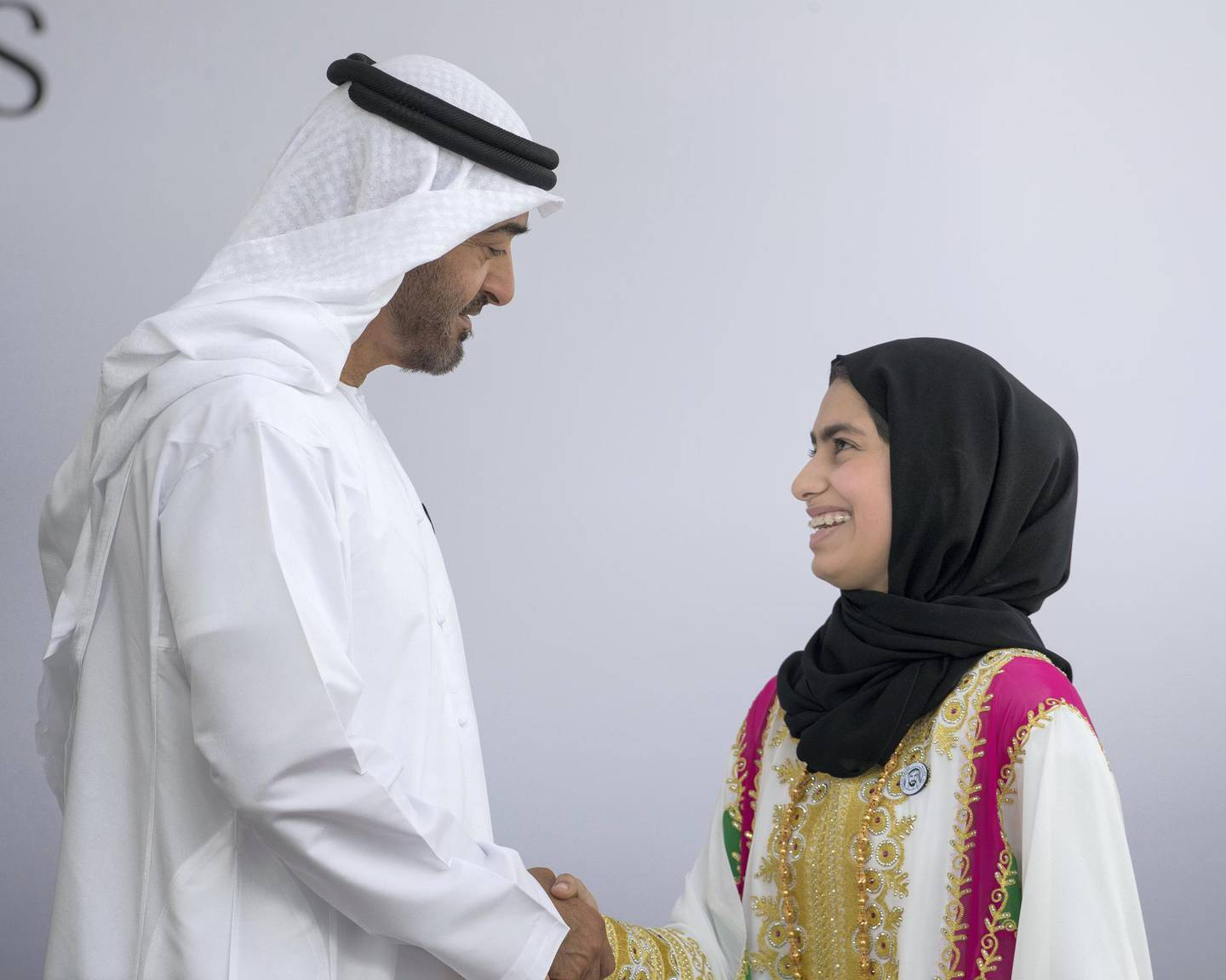 ABU DHABI, UNITED ARAB EMIRATES -  March 12, 2018: HH Sheikh Mohamed bin Zayed Al Nahyan, Crown Prince of Abu Dhabi and Deputy Supreme Commander of the UAE Armed Forces (L), presents an Abu Dhabi Award to Fatima Ali Al Kaabi (R), during the awards ceremony at the Sea Palace. ( Ryan Carter for the Crown Prince Court - Abu Dhabi ) ---
