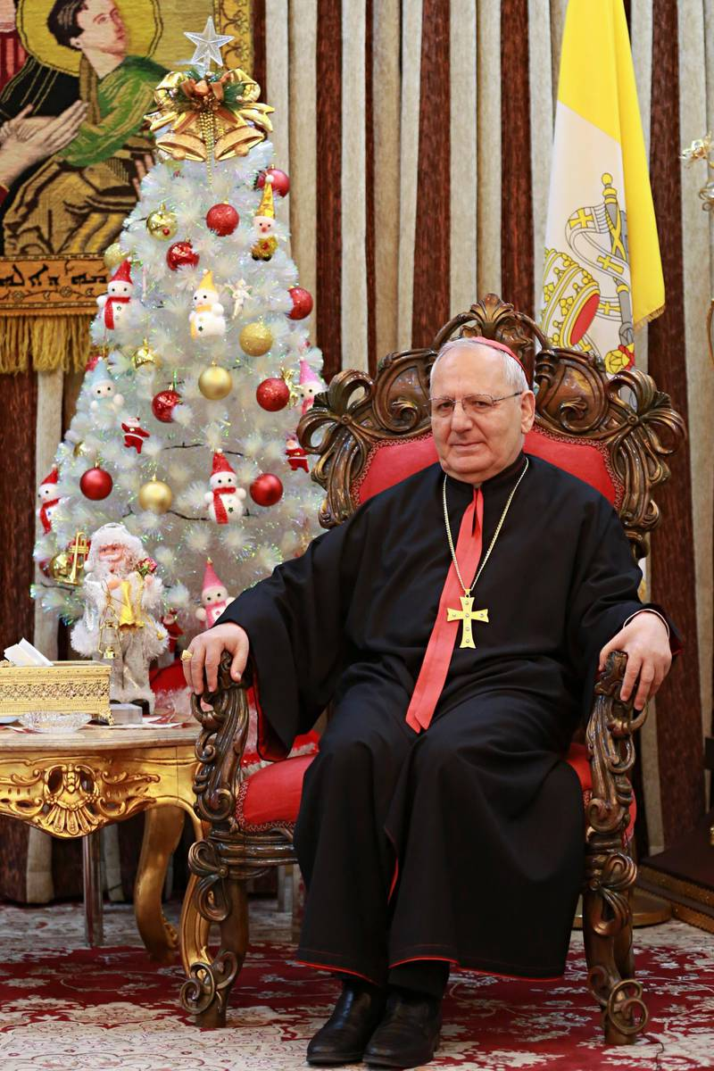 FILE -- In this Monday, Dec. 18, 2017 photo, Louis Raphael Sako, Chaldean Patriarch speaks during an interview with The Associated Press in Baghdad, Iraq. In a surprise announcement to pilgrims and tourists, Pope Francis has announced that he will make 14 new cardinals next June 29, among which is Chaldean Pathriach Sako. (AP Photo/Khalid Mohammed)