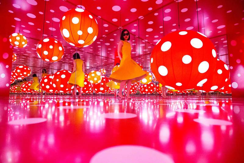 Sharjah, United Arab Emirates, January 9, 2017:    Thanita Denkaew an expatriate from Thailand spins inside the Dot Obsessions installation by Japanese artist Yayoi Kusama at Sharjah Art Foundation in the Heart of Sharjah area of Sharjah on January 9, 2017. Christopher Pike / The National  Job ID:  Reporter:  N/A Section: News Keywords: POSSIBLE FOCAL POINT *** Local Caption ***  CP0109-na-stand alone02.JPG