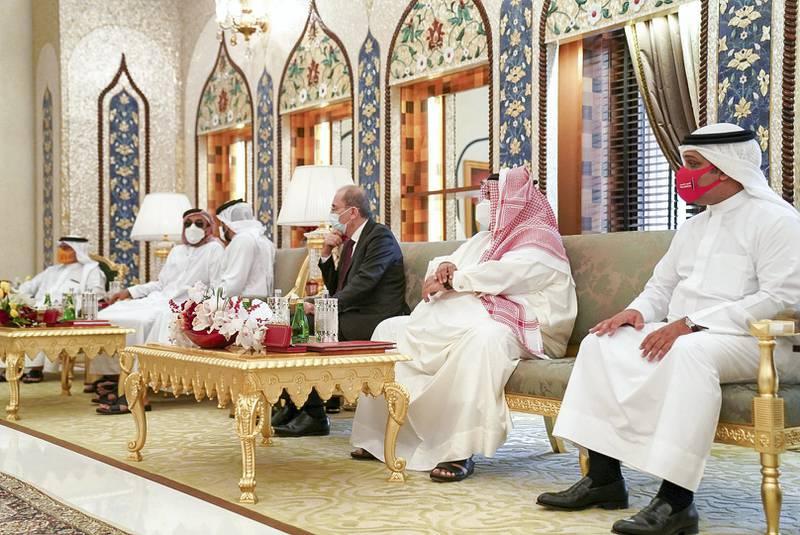 GHANTOOT, ABU DHABI, UNITED ARAB EMIRATES - November 18, 2020: HH Sheikh Ahmed bin Khalifa Al Khalifa Advisor to the King of Bahrain (R), HE Sheikh Khaled bin Ahmed bin Mohamed Al Khalifa, former Minister of Foreign Affairs of Bahrain (2nd L), HE Ayman Safadi, Minister of Foreign Affairs of Jordan (3rd L) and other dignitaries, attend a tripartite summit between the UAE, Bahrain and Jordan.   ( Rashed Al Mansoori / Ministry of Presidential Affairs ) ---