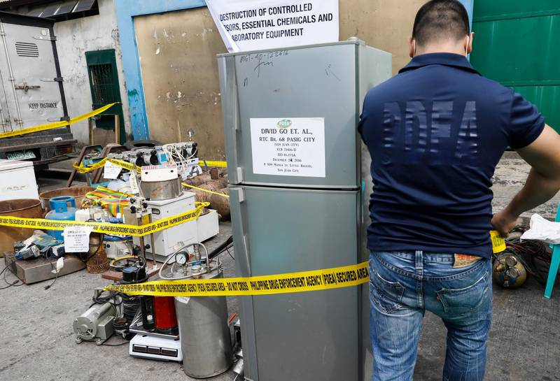 epa06260164 A personnel of the Philippine Drug Enforcement Agency (PDEA) puts caution tape around seized equipment for the manufacture of illegal drugs, before a destruction procedure in Valenzuela City, north of Manila, Philippines, 12 October 2017. The PDEA destroyed seized chemicals, materials and equipment for manufacturing illegal drugs worth some 10.7-million pesos (176,000 euro) as part of an anti-illegal drugs campaign. Philippine President Rodrigo Duterte issued a memorandum dated 10 October giving the PDEA sole responsibility to lead anti-illegal drugs operations in the country, effectively halting operations headed by the Philippine National Police and other government agencies concerned.  EPA/ROLEX DELA PENA