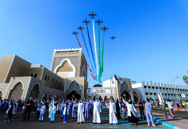 Abu Dhabi, United Arab Emirates, June 21, 2020.     The UAE Air Force's aerobatic display team, Al Fursan,  flies over Sheikh Khalifa Medical City, in an initiative of appreciation by the General Command of the UAE Armed Forces for the nation's medical teams and staff.Victor Besa  / The NationalSection:  NAReporter: