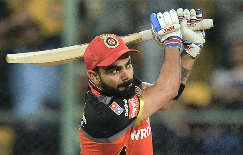Royal Challengers Bangalore captain and batsman Virat Kohli plays a shot during the 2019 Indian Premier League (IPL) Twenty20 cricket match between Royal Challengers Bangalore and Rajasthan Royals at The M. Chinnaswamy Stadium in Bangalore on April 30, 2019. - The match resumed after the rains stopped and each team will play five overs each. (Photo by Manjunath KIRAN / AFP) / ----IMAGE RESTRICTED TO EDITORIAL USE - STRICTLY NO COMMERCIAL USE----- / GETTYOUT