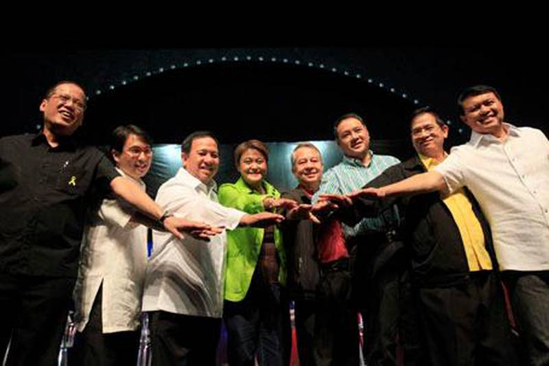 Presidential candidates for the May 10 national elections, from left, Benigno Aquino III, John Carlos de los Reyes, Richard Gordon, Jamby Madrigal, Nicanor Perlas, Gilbert Teodoro, Eddie Villanueva and Manuel Villar join their hands together prior to the start of the Philippine Daily Inquirer-sponsored presidential debate Monda, Feb. 8, 2010 at the University of the Philippines campus at Manila's Quezon city. The official campaign period for the Philippines' first-ever automated elections starts Tuesday, Feb. 9.  (AP Photo/Bullit Marquez) *** Local Caption ***  XBM102_Philippines_Elections.jpg *** Local Caption ***  XBM102_Philippines_Elections.jpg