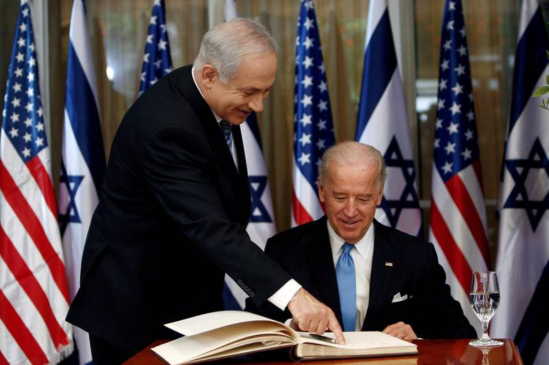 FILE PHOTO: U.S. Vice President Joe Biden (R) prepares to sign the guest book before his meeting with Israel's Prime Minister Benjamin Netanyahu at Netanyahu's residence in Jerusalem March 9, 2010. REUTERS/Ronen Zvulun/File Photo
