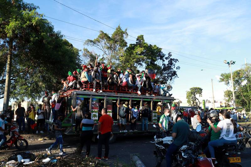 Colombian indigenous people travel on buses to participate in a protest against poverty and police violence in Cali, Colombia May 4, 2021. REUTERS/Juan B. Diaz NO RESALES. NO ARCHIVES