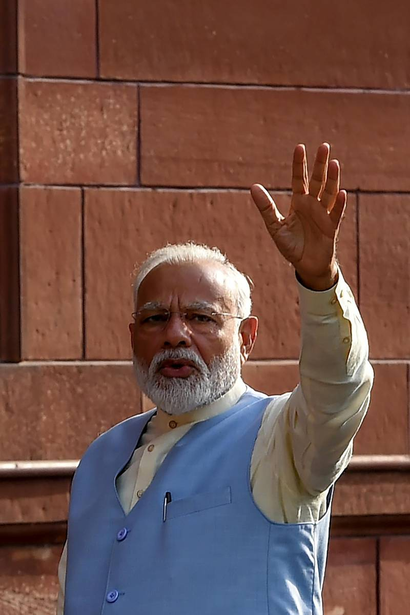 Indian Prime Minister Narendra Modi waves to the media as he arrives to attend a meeting with his newly-named cabinet in New Delhi on May 31, 2019. - India's Prime Minister Narendra Modi on May 31 named his trusted aide Amit Shah to the key home affairs ministry as part of a major cabinet shakeup for his second term in office. (Photo by Money SHARMA / AFP)