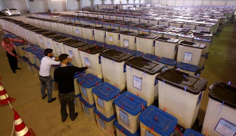 FILE PHOTO: Employees of the Iraqi Independent High Electoral Commission inspect ballot boxes at a warehouse in Najaf, Iraq May 15, 2018. REUTERS/Alaa al-Marjani/File Photo