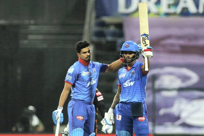 Shikhar Dhawan of Delhi Capitals raises his bat after scoring a fifty during the qualifier 2 match of season 13 of the Dream 11 Indian Premier League (IPL) between the Delhi Capitals and the Sunrisers Hyderabad at the Sheikh Zayed Stadium, Abu Dhabi in the United Arab Emirates on the 8th November 2020.  Photo by: Vipin Pawar  / Sportzpics for BCCI