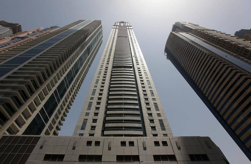 DUBAI , UNITED ARAB EMIRATES Ð June 13 : View of the Princess tower ( center ) in Dubai Marina in Dubai. ( Pawan Singh / The National ) For News summer series modern icons. Story by Manal