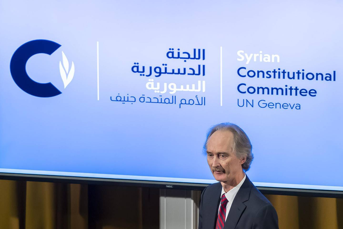 epa07959638 Geir O. Pedersen (R), Special Envoy for Syria, leaves the poduim after the first meeting of the Syrian Constitutional Committee, at the European headquarters of the United Nations in Geneva, Switzerland, 30 October 2019.  EPA/MARTIAL TREZZINI