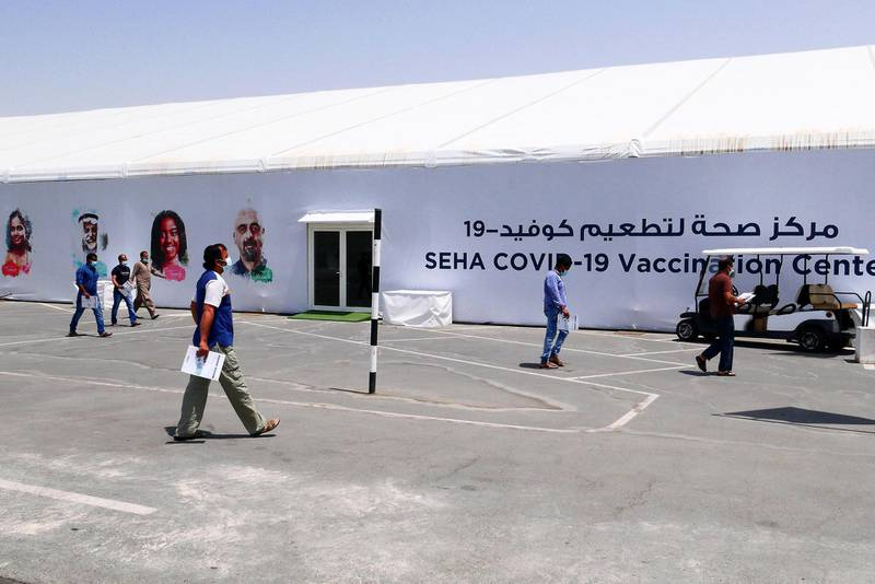People going to get their Covid vaccine at the SEHA Covid vaccination center at Dubai Parks and Resorts in Dubai on April 26,2021. (Pawan Singh/The National). Story by Nick Webster
