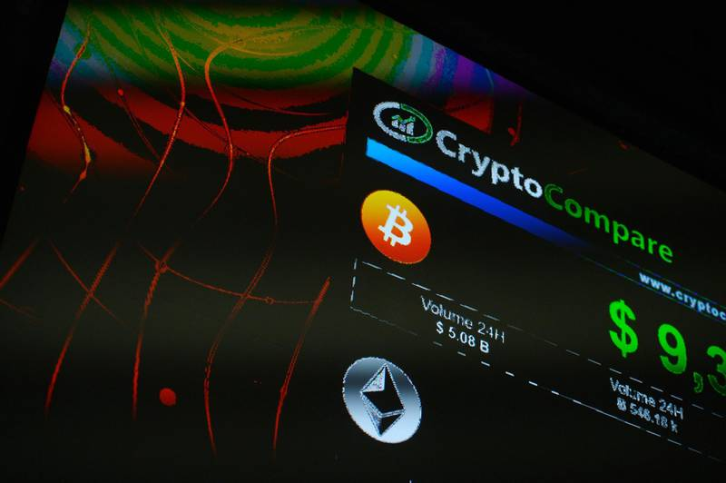 The symbols of Bitcoin and Ethereum cryptocurrencies sit displayed on a screen during the Crypto Investor Show in London, U.K., on Saturday, March 10, 2018. The meeting is the largest crypto and blockchain event for investors in the U.K. Photographer: Mary Turner/Bloomberg