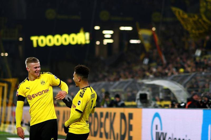 DORTMUND, GERMANY - JANUARY 24: Erling Haland of Borussia Dortmund celebrates scoring his second goal of the game with team mate Jadon Sancho during the Bundesliga match between Borussia Dortmund and 1. FC Koeln at Signal Iduna Park on January 24, 2020 in Dortmund, Germany. (Photo by Dean Mouhtaropoulos/Bongarts/Getty Images)