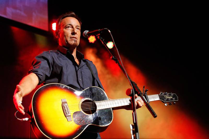"""(FILES) In this file photo taken on November 6, 2013, Bruce Springsteen performs at the 7th annual """"Stand Up For Heroes"""" event at Madison Square Garden in New York City.   US rocker Bruce Springsteen announced on June 7, 2021 that his eponymous hit Broadway show will reopen in June, making him the first megastar to perform for an indoor audience at a major venue since the city began reopening.  / AFP / GETTY IMAGES NORTH AMERICA / Jemal Countess"""