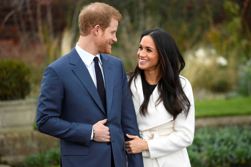 Britain's Prince Harry poses with Meghan Markle in the Sunken Garden of Kensington Palace, London, Britain, November 27, 2017. REUTERS/Toby Melville