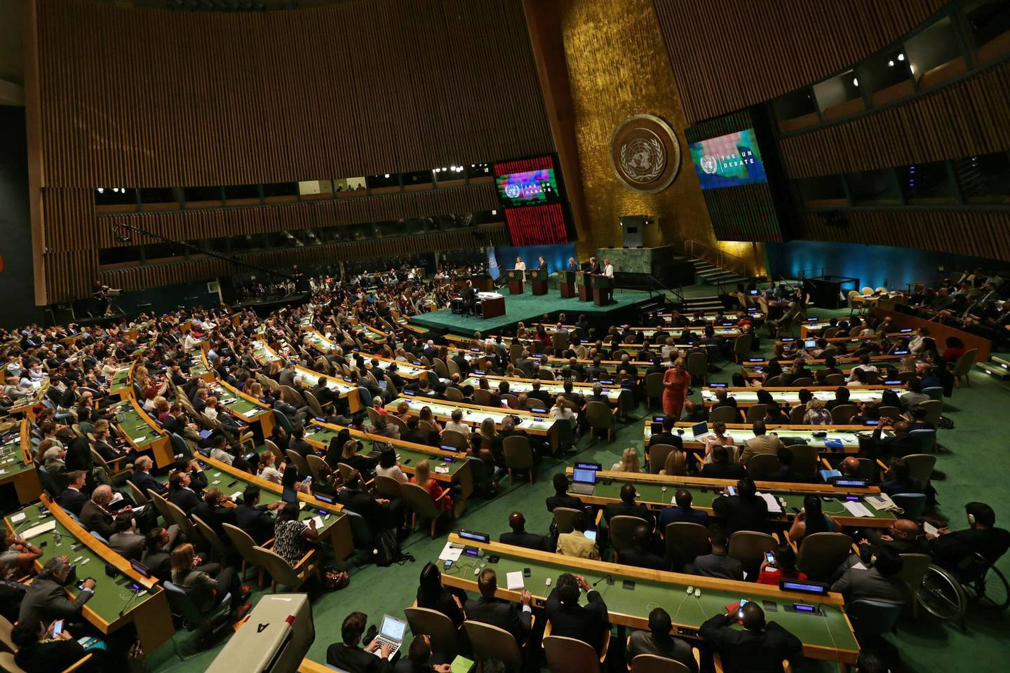 epa08668129 epa05422294 A general view shows the General Assembly Hall as candidates for the post of United Nations Secretary-General (back) attend a Global town hall meeting at United Nations (UN) Headquarters in New York, New York, USA, 12 July 2016 (reissued 14 September 2020). The 75th UN General Assembly (UNGA) session begins on 15 September 2020 with most meetings including the General Debate on 22 September being held in a virtual format due to the ongoing coronavirus pandemic.  EPA/PETER FOLEY *** Local Caption *** 52885085