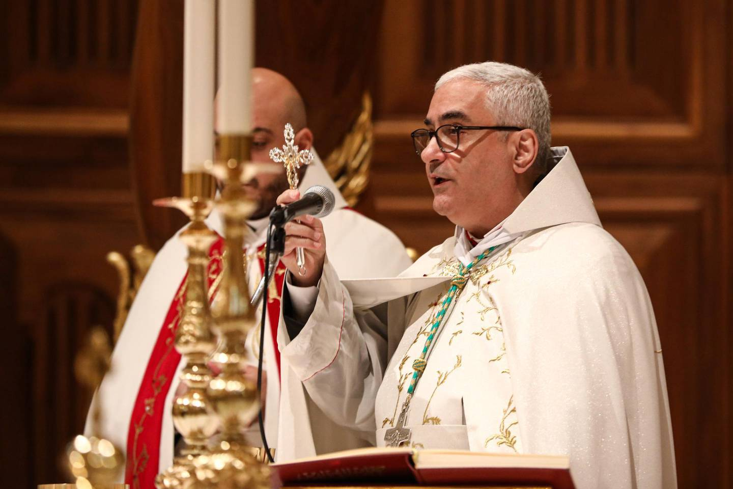 Bishop Paul Abdel Sater, Curial bishop of the Maronite Catholic Patriarchate of Antioch, holds up a crucifix as he speaks during the Christmas Morning mass at the Maronite Cathedral of St George in the capital Beirut's downtown district on Christmas Day on December 25, 2019. (Photo by ANWAR AMRO / AFP)