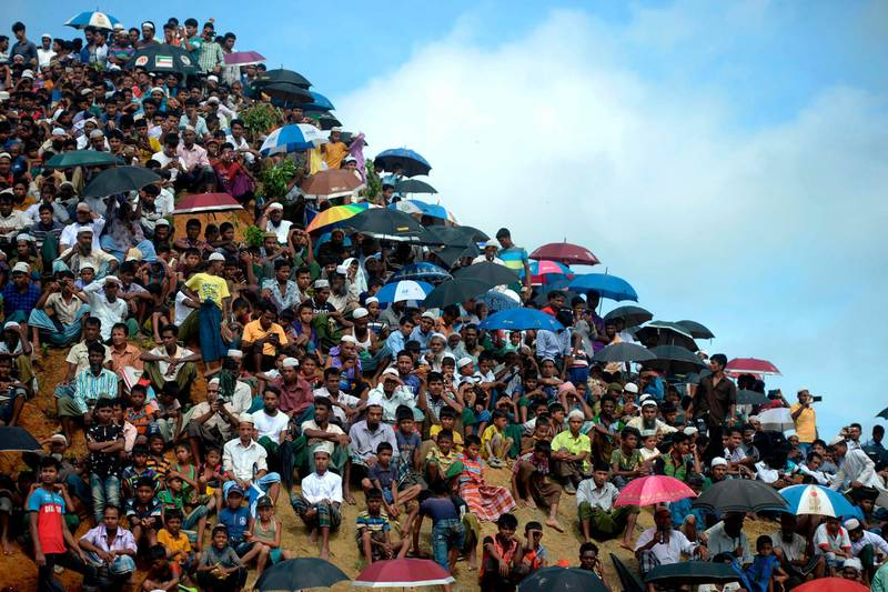 TOPSHOT - Rohingya refugees attend a ceremony organised to remember the second anniversary of a military crackdown that prompted a massive exodus of people from Myanmar to Bangladesh, at the Kutupalong refugee camp in Ukhia on August 25, 2019. Some 200,000 Rohingya rallied in a Bangladesh refugee camp on August 25 to mark two years since they fled a violent crackdown by Myanmar forces, just days after a second failed attempt to repatriate the refugees. / AFP / MUNIR UZ ZAMAN