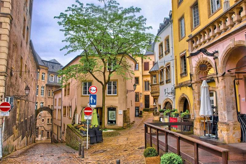 LUXEMBOURG CITY, LUXEMBOURG - JUN 2013: Narrow medieval street with cafes on June 9, 2013 in Luxembourg city, Luxembourg
