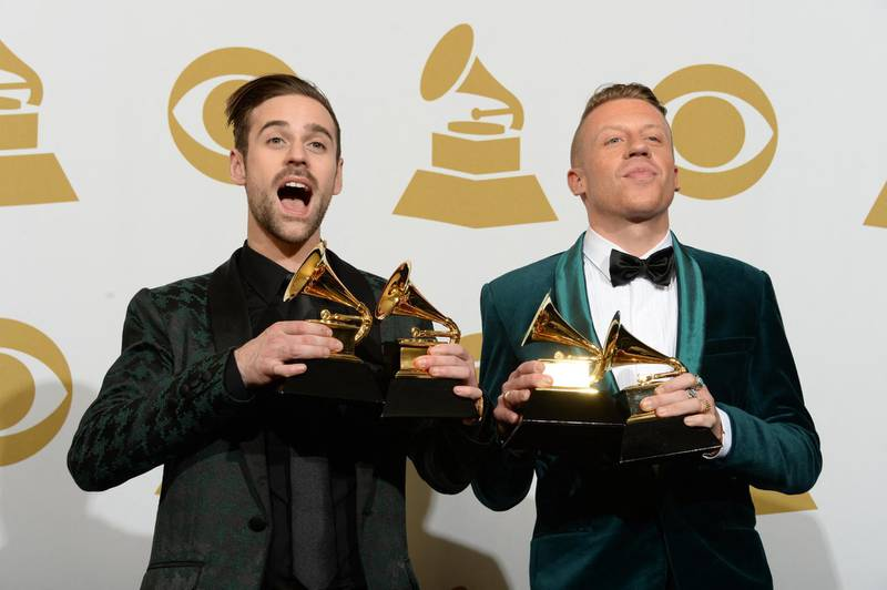 Macklemore (R) and Ryan Lewis pose with their awards in the press room during the 56th Grammy Awards at the Staples Center in Los Angeles on January 26, 2014.    AFP PHOTO/Joe KLAMAR (Photo by JOE KLAMAR / AFP)