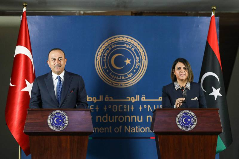(R to L) Libya's Foreign Minister Najla al-Mangoush and Turkish counterpart Mevlut Cavusoglu give a joint press conference in the capital Tripoli on May 3, 2021.  / AFP / Mahmud Turkia
