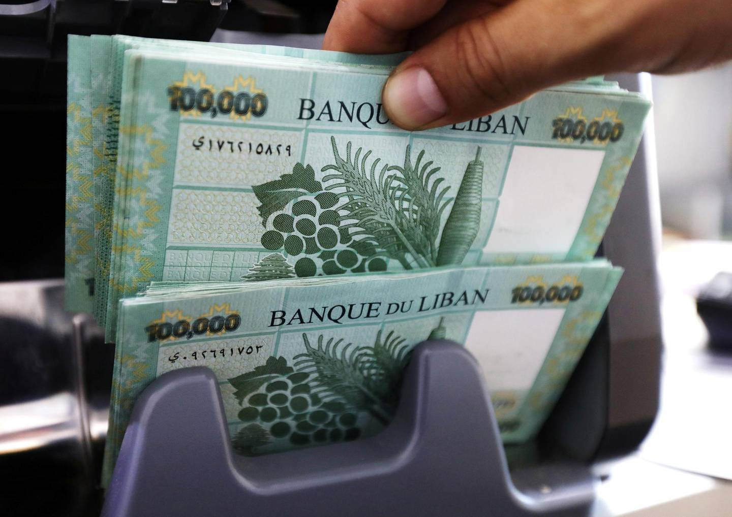 FILE PHOTO: Lebanese pound banknotes are seen at a currency exchange shop in Beirut, Lebanon June 15, 2020. REUTERS/Mohamed Azakir/File Photo