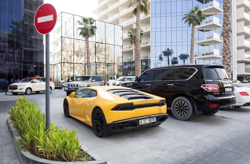 DUBAI, UNITED ARAB EMIRATES, 07 August 2018 - A Lamborghini car involve in a 170,000 speeding fine parked at Five Hotel, Palm Jumeirah, Dubai.  Leslie Pableo for The National