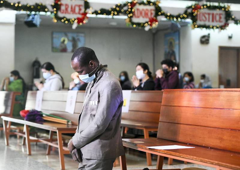 Abu Dhabi, United Arab Emirates - Devotee during Christmas mass at St. JosephÕs Cathedral, in Mushrif. Khushnum Bhandari for The National