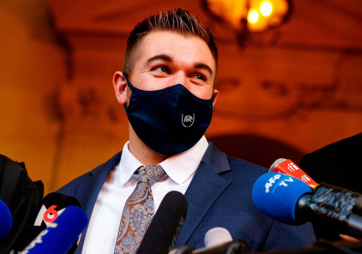 """US former serviceman Alek Skarlatos speaks to the press at the """"Palais de Justice"""" courthouse in Paris, on November 20, 2020, on the second day of the trial of Ayoub El Khazzani, a Moroccan man whose attempted terror attack on an Amsterdam-Paris Thalys train in 2015 was foiled by passengers, including Sadler who tackled him along with his friends Spencer Stone and Alek Skarlatos, then off-duty US soldiers. Ayoub El Khazzani and three alleged accomplices went on trial in Paris on November 16 for the attempted terror attack foiled by passengers. Gunman Ayoub El Khazzani was tackled by passengers shortly after emerging bare-chested and heavily armed from a toilet on a Thalys high-speed train on August 21, 2015. There were some 150 passengers in the carriage with Khazzani, who had an AK47 slung over his back, and a bag of nearly 300 rounds of ammunition. / AFP / Thomas SAMSON"""