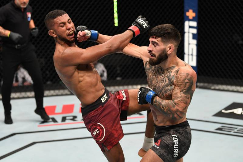 ABU DHABI, UNITED ARAB EMIRATES - OCTOBER 11:  (R-L) Ilia Topuria punches Youssef Zalal of Morocco in their featherweight bout during the UFC Fight Night event inside Flash Forum on UFC Fight Island on October 11, 2020 in Abu Dhabi, United Arab Emirates. (Photo by Josh Hedges/Zuffa LLC via Getty Images)