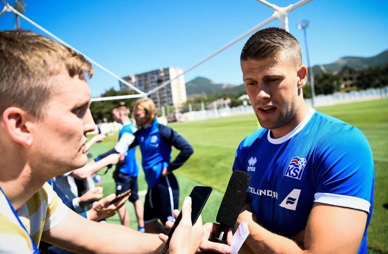 Iceland's midfielder Johann Gudmundsson speaks to the media before a football training session at Olimp Stadium in Kabardinka on June 11, 2018, ahead of the Russia 2018 World Cup.  / AFP / Jonathan NACKSTRAND