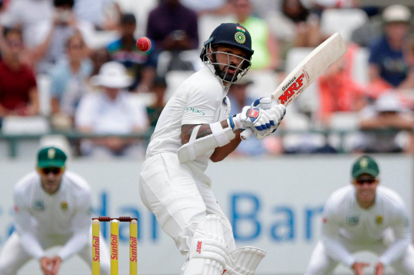 Indian batsman Shikhar Dhawan avoids a bouncer during the fourth day of the first Test cricket match between South Africa and India at Newlands cricket ground on January 8, 2018 in Cape Town, South Africa.   / AFP PHOTO / GIANLUIGI GUERCIA