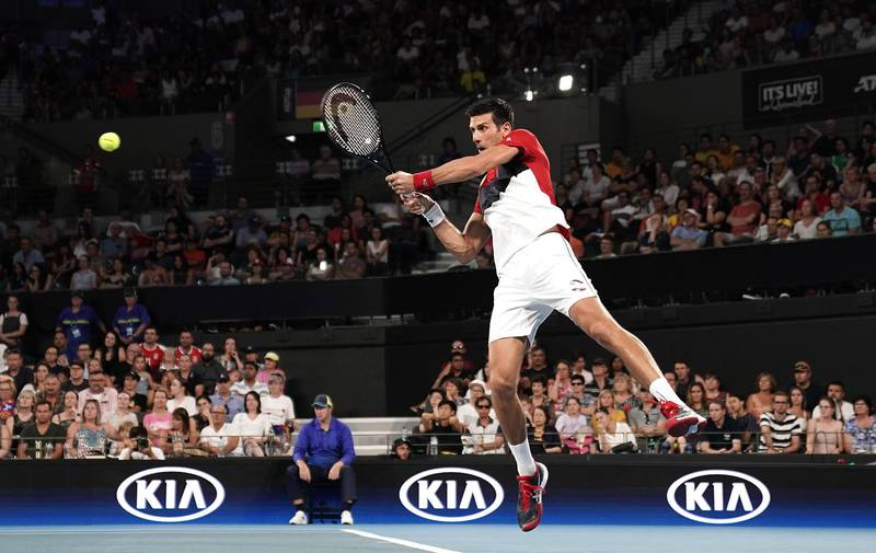 epa08101846 Novak Djokovic of Serbia in action during his singles match against Kevin Anderson of South Africa on day 2 of the ATP Cup tennis tournament at Pat Rafter Arena in Brisbane, Australia, 04 January 2020.  EPA/DAVE HUNT  AUSTRALIA AND NEW ZEALAND OUT  EDITORIAL USE ONLY