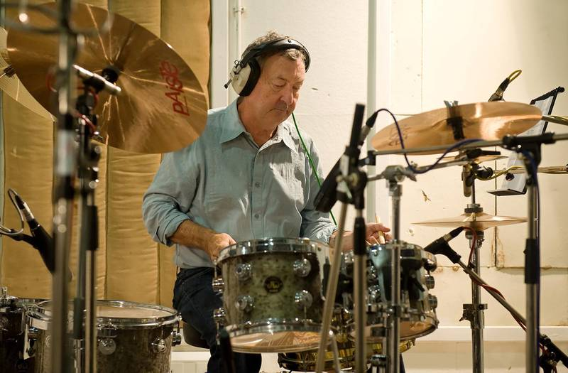 """Pink Floyd drummer Nick Mason takes part in a charity recording of a Children in Need album at Abbey Road studios in west London on September 7, 2009. The group including Sir Terry Wogan, former Rolling Stone Bill Wyman, singer Midge Ure and many others will be recording a version of the Beatles' classic """"All You Need Is Love"""" for the forthcoming """"Bandaged Together"""" album. AFP PHOTO/Leon Neal (Photo by LEON NEAL / AFP)"""