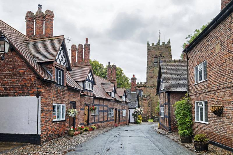 16th century grade 11 listed homes in the main street of the village of great budworth in cheshire, England. (Photo by: Kevin Britland/Education Images/Universal Images Group via Getty Images)