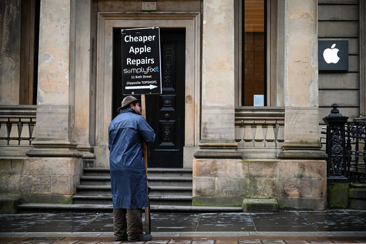 GLASGOW,  - MARCH 18: A man stands outside the closed Apple Mac store in Buchanan Street on March 18, 2020 in Glasgow, Scotland. People have been asked to work from home and socially distance themselves due to the coronavirus (COVID-19) pandemic. (Photo by Jeff J Mitchell/Getty Images)