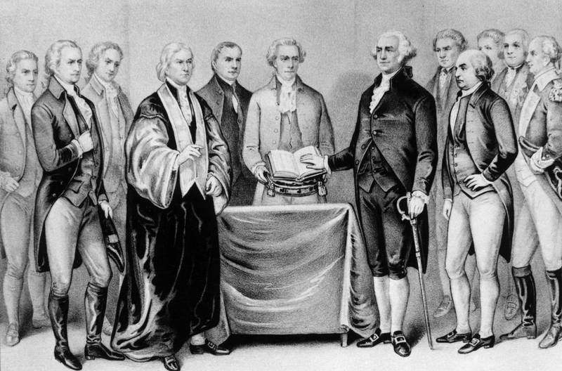 1788:  The inauguration of George Washington as the first President of the United States, also present are (from left) Alexander Hamilton, Robert R Livingston, Roger Sherman, Mr Otis, Vice President John Adams, Baron Von Steuben and General Henry Knox.  Original Artwork: Printed by Currier & Ives.  (Photo by MPI/Getty Images)