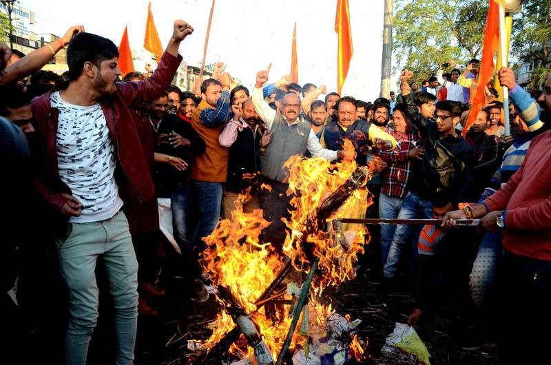 epa06470996 Indian Rajput community members protest and burn the effigy of Sanjay Leela Bhansali, the director of  Bollywood movie 'Padmavat', against the film's release, in Bhopal, India, 24 January 2018. According to media reports, the movie featuring Indian actress Deepika Padukone, Shahid Kapoor, and Ranveer Singh, is set for release on 25 January 2018, after the Central Board of Film Certification (CBFC) clearance. The movie is facing protest by Rajput groups in several states of India, with protesters claiming historical inaccuracies and called for the film to be banned. The period epic tells the story of a 14th century Hindu queen who belonged to the Rajput caste and Muslim ruler Alauddin Khilji. Protestors held various placards some of them read 'India will not tolerate insult of an Indian woman', 'In honor Rani Padmavati Jawar (self immolation), Integrated Nationalist Party in the field', and 'Fight is not of caste and religion, its for the virtuous women' in Hindi.  EPA/SANJEEV GUPTA