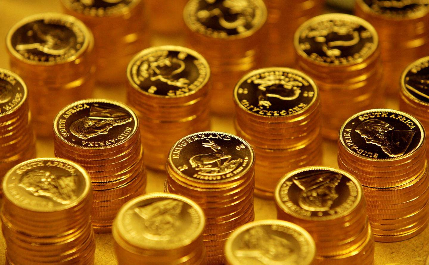 FILE PHOTO: Gold bullion coins known as Krugerrands are pictured in the mint where they are manufactured in Midrand outside Johannesburg October 3, 2008. REUTERS/Siphiwe Sibeko (SOUTH AFRICA)/File Photo