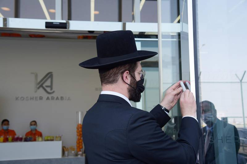 Rabbi Krakowski, head of OU's Israel branch, opened Kosher Arabia's facility this week, performing a ceremony placing the Mezuzah, a piece of parchment called a klaf contained in a case and inscribed with specific Hebrew verses from the Torah, at the entrance.
