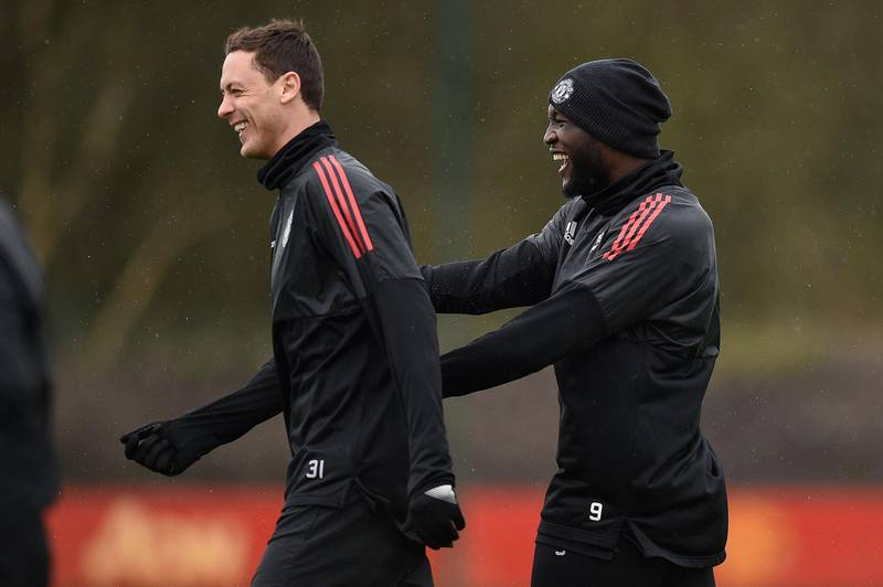 Manchester United's Serbian midfielder Nemanja Matic (L) and Manchester United's Belgian striker Romelu Lukaku attend a team training session at the club's training complex near Carrington, west of Manchester in north west England on March 12, 2018, on the eve of their UEFA Champions League round of 16 second-leg football match against Sevilla. / AFP PHOTO / Oli SCARFF